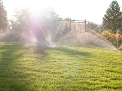 Sprnklers watering grass