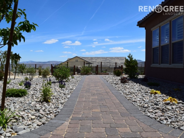 paver pathway rock mulched planters backyard