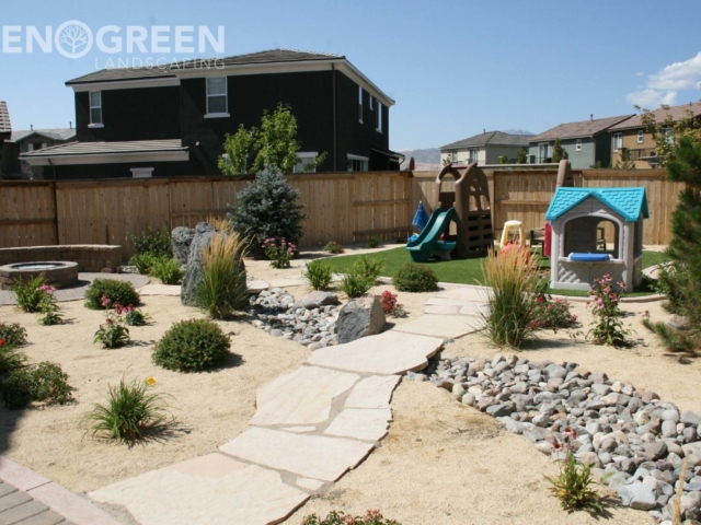 flagstone pathway dry creek bed xeriscape kids play area fire pit artificial turf