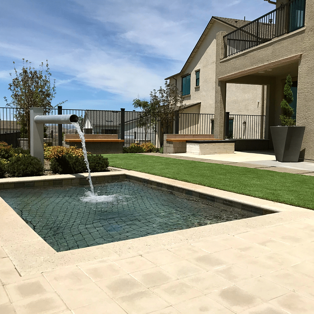 backyard outdoor living water feature artificial turf