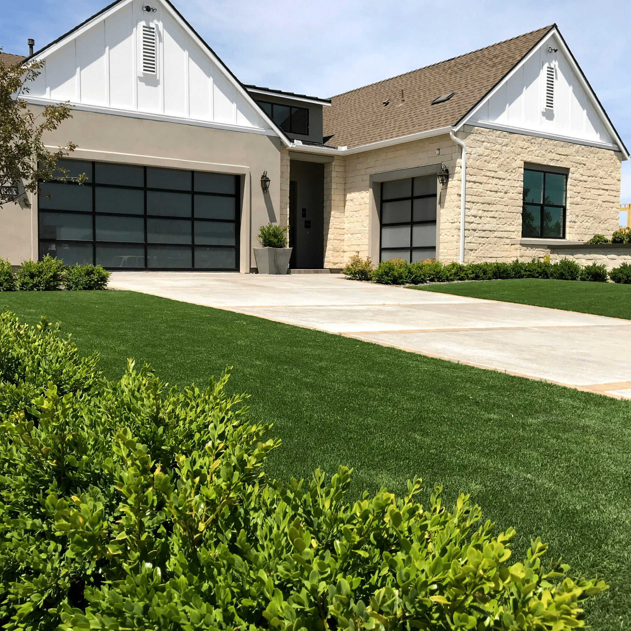 front yard paver driveway artificial turf