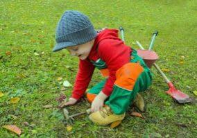kid pulling weeds