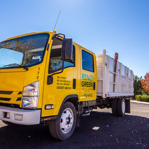 reno green commercial landscape maintenance truck in commercial setting